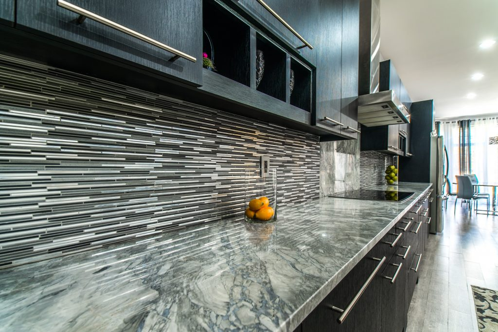 Marble countertop with tile backsplash