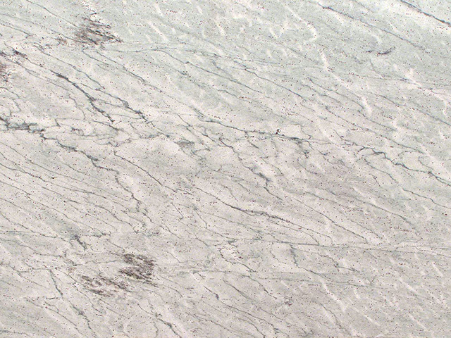 River White granite is a staple in the countertop industry. Gray and White veins plus its iconic Burgandy specks.