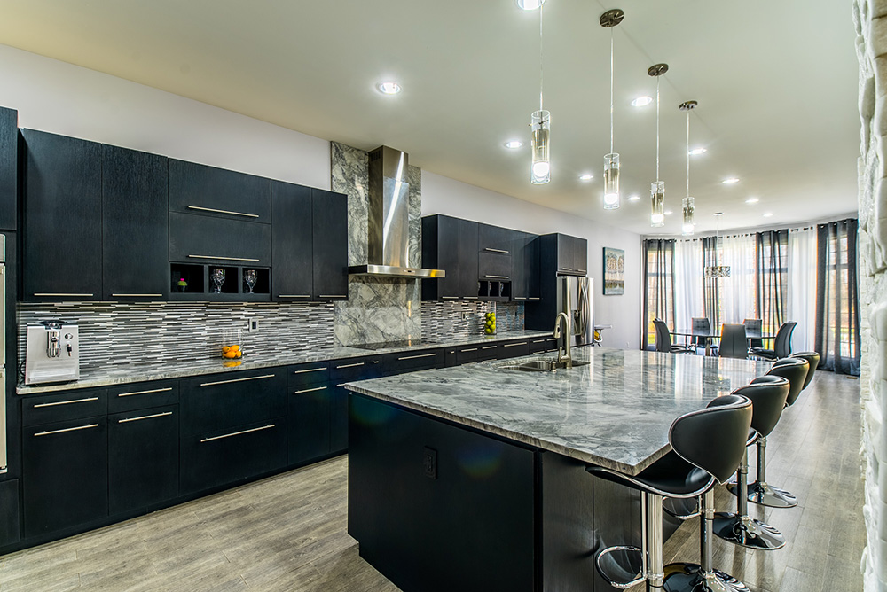 Large Modern Kitchen With Super White Marble Countertops Dark Cabinets Stacked Tile Backsplash And